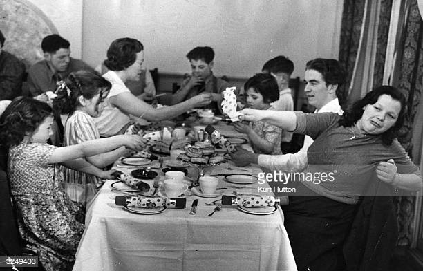 Some of the Hudson family's twenty children enjoying themselves at a Christmas lunch in Selfridges department store London Original Publication...