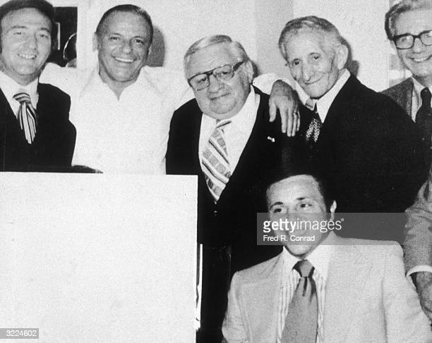American actor and singer Frank Sinatra posing with a group of reputed mobsters at a Westchester theater New York LR Gregory DePalma Sinatra Thomas...