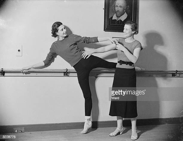 Joy Newton , of the Sadler's Wells Vic-Wells Ballet gives Elizabeth Cowell a private ballet class, as a means of keeping fit. Miss Cowell is a BBC...