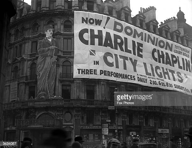 A banner across the front of the Dominion Theatre Tottenham Court Road London advertising the opening of 'City Lights' starring Charlie Chaplin