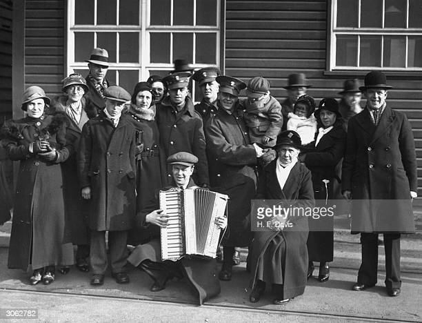 Soldiers from the 1st Battalion of Northumberland Fusiliers with their families at Southampton after returning from duty in the West Indies.