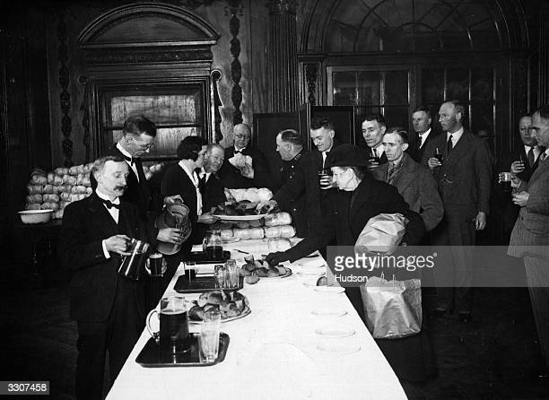 The Stationers' Company observing the Ash Wednesday custom dating from 1612 of drinking a pint of old ale and eating a spiced bun at Stationers' Hall...