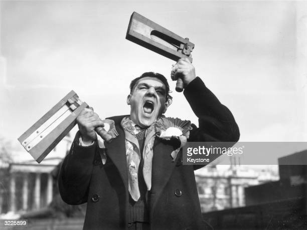 On his arrival in London Leicester City fan George Hughes cheers and waves his rattles fervently in support of his team before their Cuptie against...
