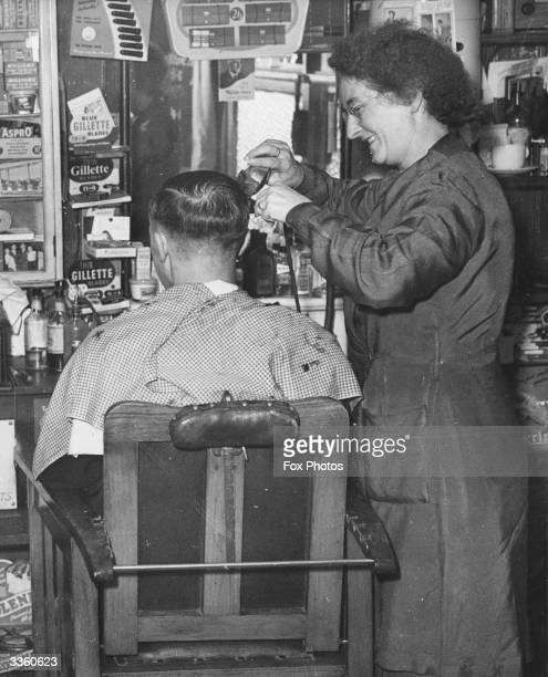 Mrs Maude Jones at work in her barber's shop in Egham Surrey