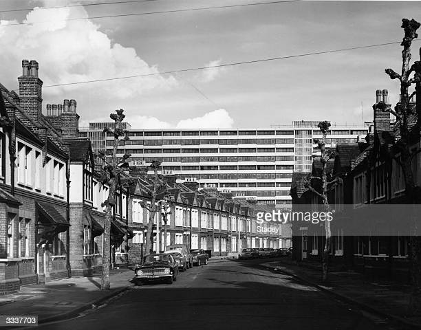 The Aylesbury Development housing estate towers over the terraced houses of Wooler Street in Southwark South London