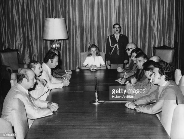 Argentinian president Isabelita Peron popular name of Maria Estela Martinez de Peron conducting a meeting with members of her Peronist party senators...