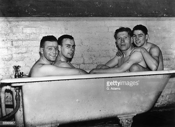 Poyser MacKenzie McCulloch and Smith of Brentford Football Club share a cramped bath after a hard training session at Bushey Hall Hertfordshire in...