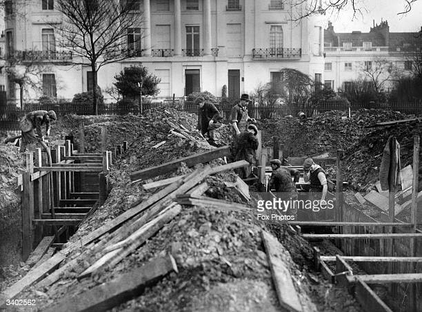 Workers concreting air raid protection trenches in Regent's Park to make them permanent and safer
