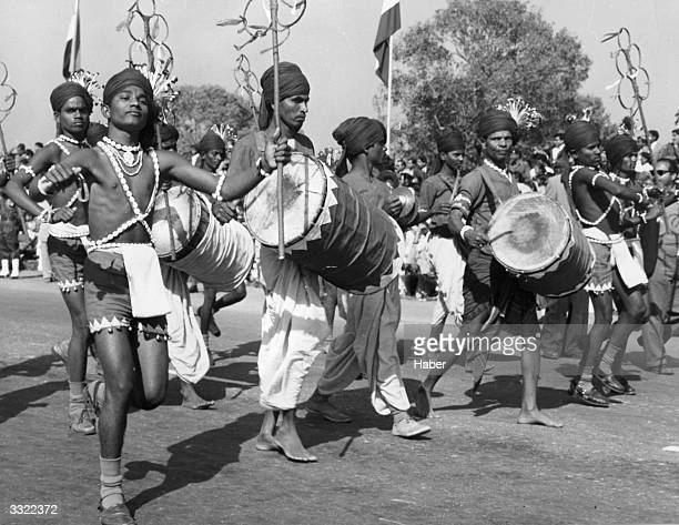 Traditional Indian dancers and drummers making their way along the processional route of India's 11th Republic Day celebrations in Delhi India which...