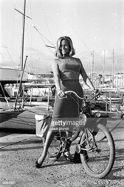 Actress Honor Blackman going for a ride on a Solex moped while in Cannes to film 'Moment To Moment'