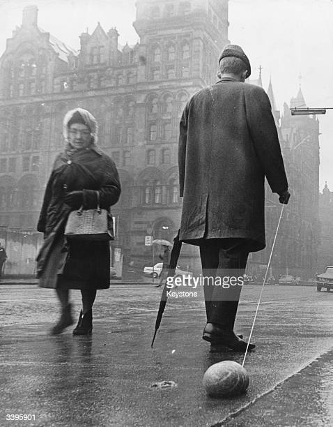 A Glasgow man attracts a puzzled gaze by pulling a haggis behind him on a piece of string on the anniversary of Scots patriot Robert Burns
