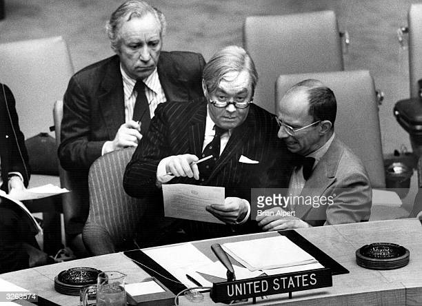 American ambassador to the United Nations Daniel Patrick Moynihan looks over a resolution on the Middle East which he was later to veto