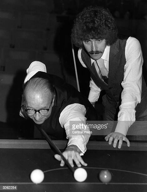 Veteran snooker player Fred Davis taking a shot while Cliff Thornburn his Canadian opponent looks on They are competing in the fifth round of the...