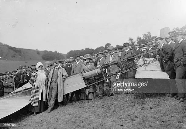 French aviation pioneer Louis Bleriot poses for a commemorative photograph with his wife and friends near Dover Castle the day after completing the...