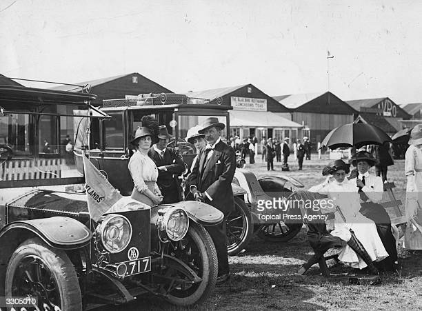 Irish journalist and newspaper magnate Alfred Charles William Harmsworth , 1st Viscount Northcliffe, at Brooklands race course with Lady Nancy Astor...