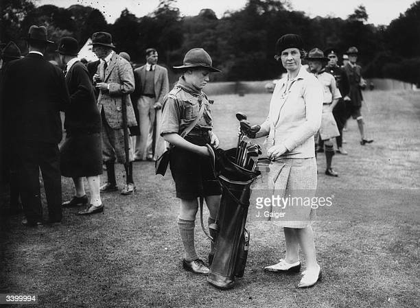 Golfer Molly Gourlay selecting a club from her boy scout caddie during a golfing competition held at Leeds Castle in aid of the Kent Playing Fields...