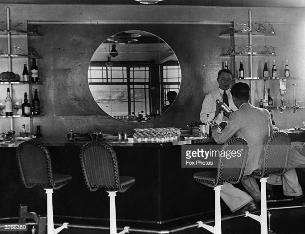 The bar at the Heston Aerodrome an early airport in London An aeroplane is reflected in the mirror