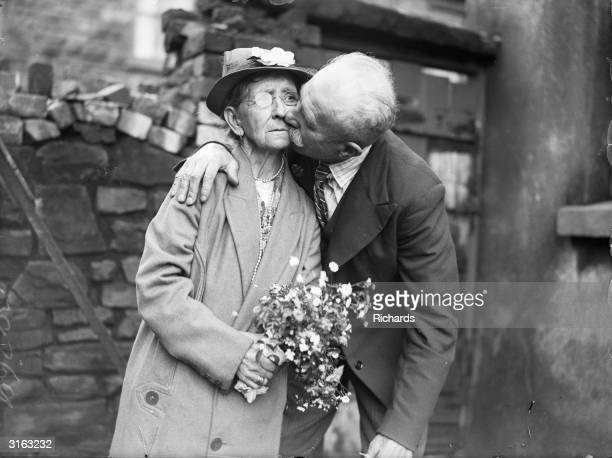 76 year old Evan Ellis of Anglesey kissing his bride 70 year old Mary Ann Kinsley after their wedding at Ton Pentre Rhondda