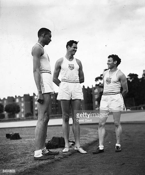The tallest and shortest members of the US athletics team in training at White City Stadium London Malvin Walker Perrin Walker and G Rice