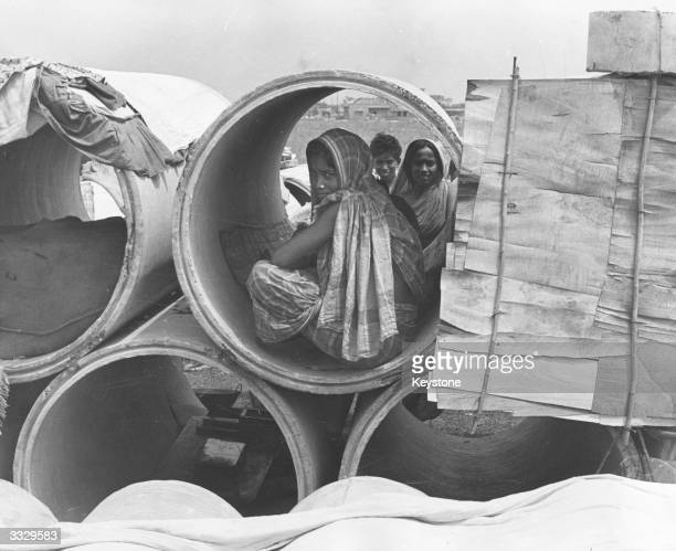 Refugees from East Pakistan taking shelter in concrete sewage pipes near Salt Lake housing colony areas in the northern outskirts of Calcutta