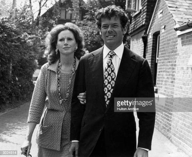 American oil heir and arts patron Gordon Getty son of oil tycoon John Paul Getty Jnr walking with his wife Ann outdoors after the marriage of Barbara...