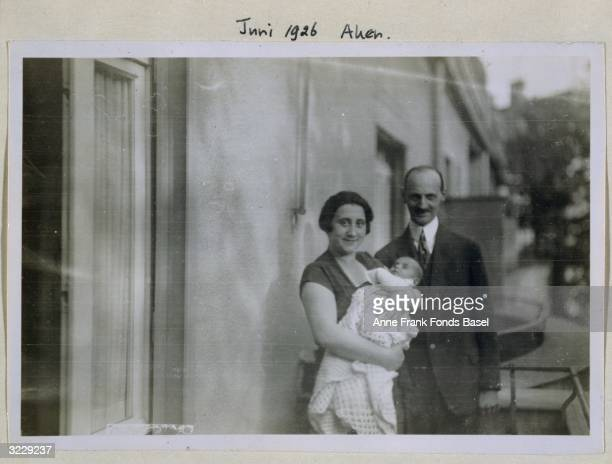 EXCLUSIVE Portrait of Edith and Otto Frank with their infant daughter Margot outdoors Aachen Germany Taken from the photo album of Anne Frank