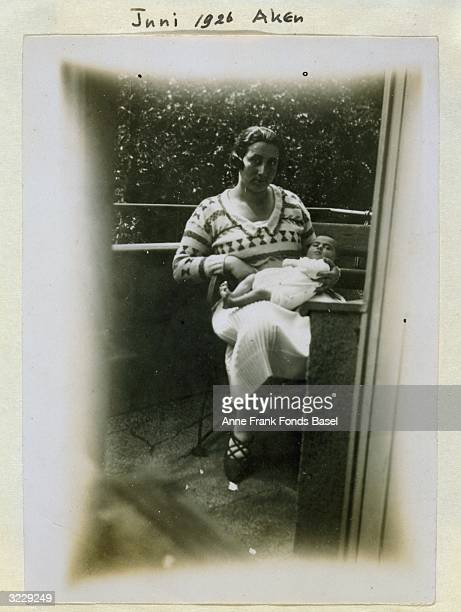 EXCLUSIVE Seated portrait of Edith Frank wearing a patterned sweater and holding her infant daughter Margot on her balcony Aachen Germany Taken from...