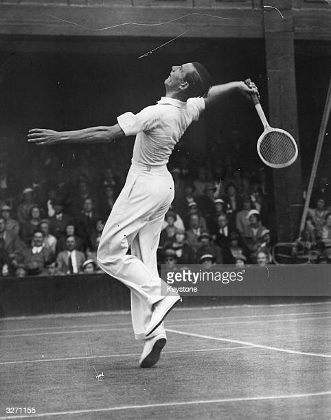 British tennis player Fred Perry in action at Wimbledon.