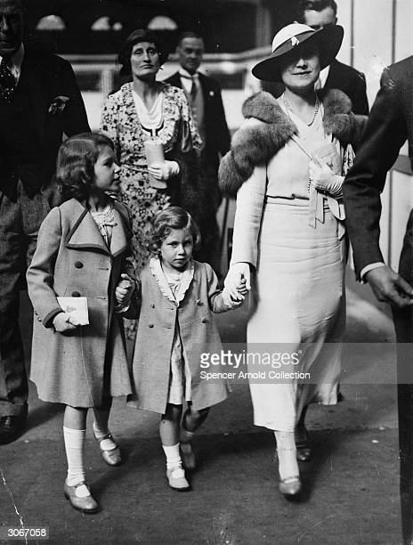 Princess Margaret Rose arrives at Olympia with her older sister Princess Elizabeth and their mother Queen Elizabeth formerly Lady Elizabeth BowesLyon...