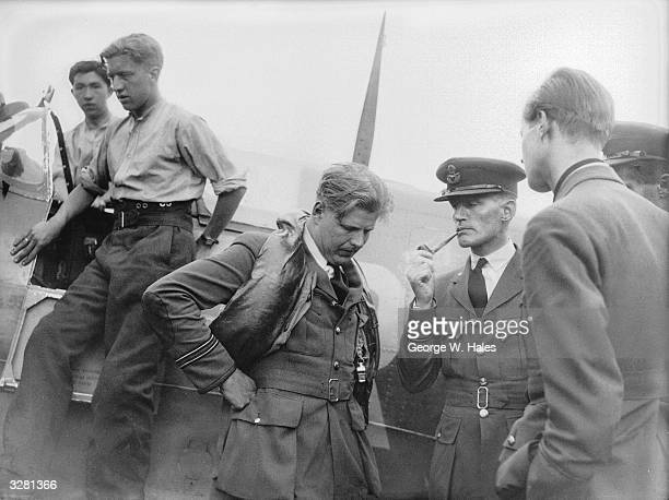 Spitfire fighter pilots reporting to the Intelligence Officer at Biggin Hill on their return from a cross Channel sweep.