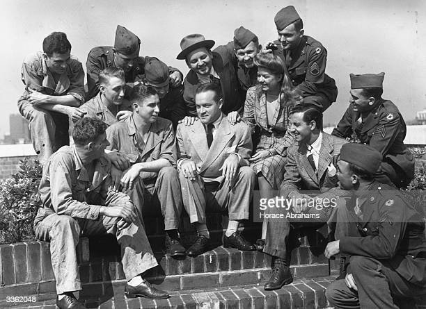 Bob Hope , British-born American comedian and film actor, with Frances Langford and American soldiers on the roof of 20 Grosvenor Square, London.