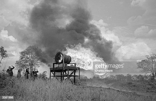 A fuel consumption test at the Lutterworth works of the British ThomsonHouston company in Leicestershire The flames burning freely here are...
