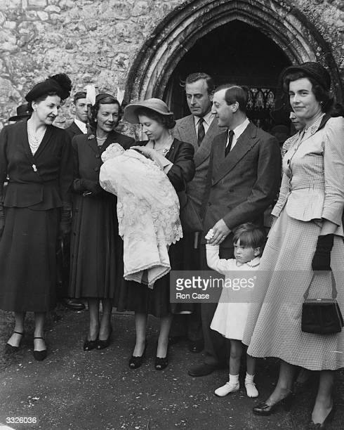 Princess Elizabeth holds the second son of Lord and Lady Brabourne Michael John Ulick after acting as Godmother at the christening at Mersham Church...