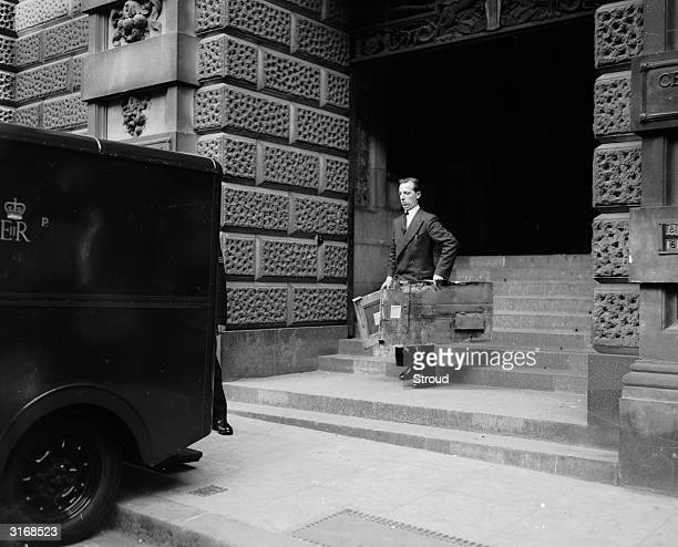 A court official at the Old Bailey in London taking exhibits from the trial of John Reginald Christie for murder