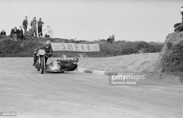 A competitor with a sidecar during a Tourist Trophy motorcycle race on the Isle of Man Original Publication Picture Post 7190 Should The TT Be...