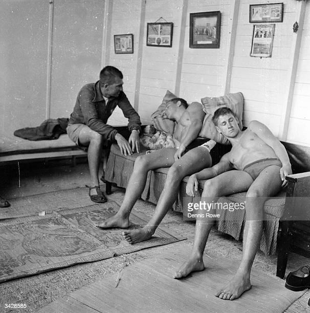 Swimmers John Hardy and Colin Ward relax in a hypnotic trance while their trainer former Olympic swimming coach Forbes Carlile uses autosuggestion to...