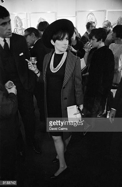 American actress and singer Barbra Streisand with her partner, American actor Elliott Gould at the opening of an exhibition at the Grosvenor Gallery.