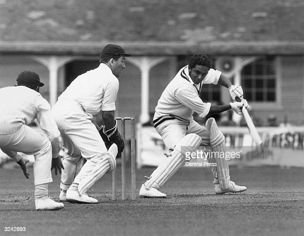 Indian cricketer Dilip Narayan Sardesai batting at Colchester during Essex vs India The wicket keeper is Brian Taylor