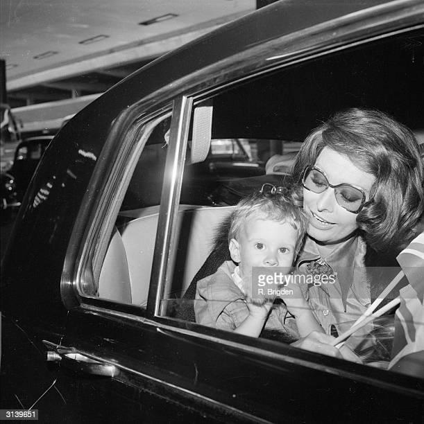 Italian actress Sophia Loren at London Airport with her younger son Edoardo Ponti