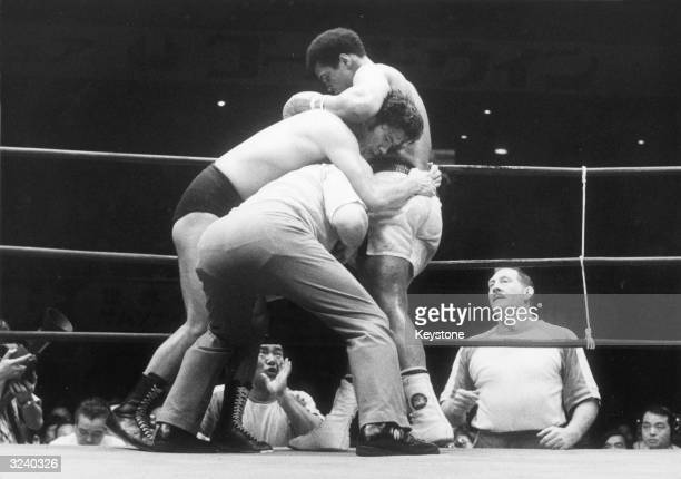 Heavyweight boxer Muhammad Ali fighting the champion Japanese wrestler Antonio Inoki at Budokan Hall in Tokyo