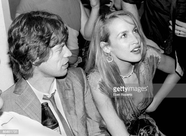 Mick Jagger from the Rolling Stones and Jerry Hall in the audience of a Jim Caroll show at Trax in New York City on 26th June 1980 Mick Jagger holds...