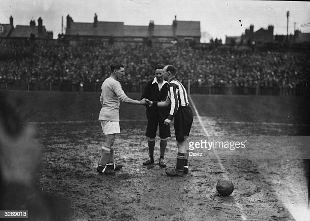 Cardiff City captain Fred Keenor and Reading captain Eggs shake hands before the start of their FA Cup semifinal match at Wolverhampton Cardiff won...