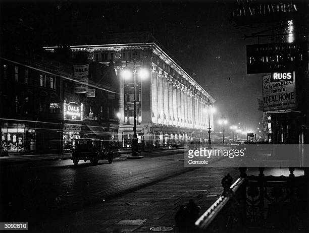 A night scene in London's Oxford Street outside the famous Selfridges department store