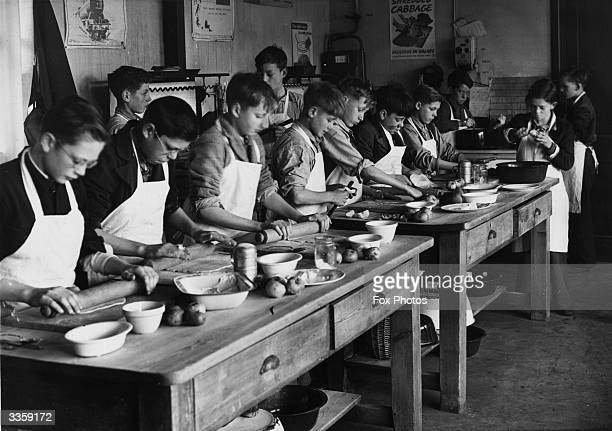 Evacuees at Swindon Road School Cheltenham preparing meals in the school kitchen The boys prepare meals on one day a week