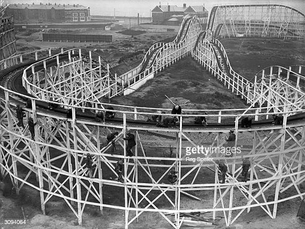 Men at work on the big dipper at a Blackpool amusement park