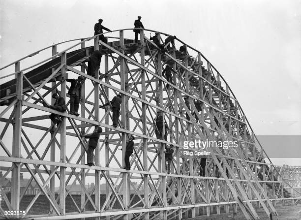 Men at work on the girders of a new switchback along the South Shore at Blackpool in readiness for the Easter holiday crowds