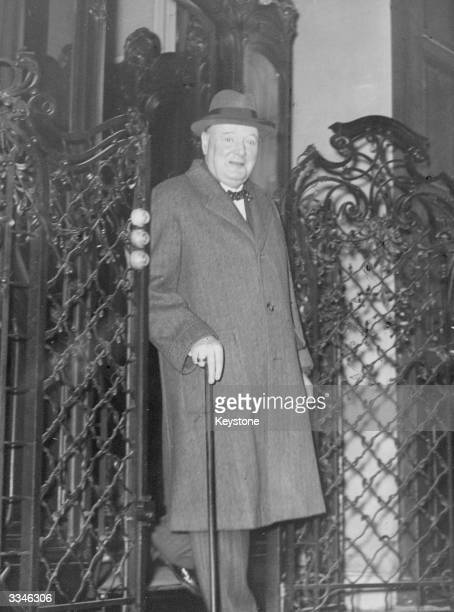 Winston Churchill leaves the ministry of Foreign Affairs in Paris after visiting M Leger .