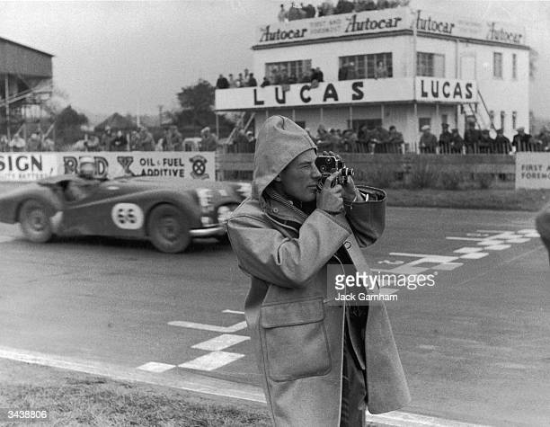 English racing driver Stirling Moss films his sister Pat competing in the Ladies' Invitation Race at Goodwood Pat Moss won the race the first women's...