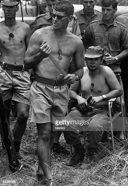 A team of commandos of the Rhodesian army during a practice session of antiterrorist manoeuvres in Rhodesia The three barechested soldiers are...