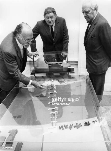 A model of the GLC Thames Flood Barrier being examined by Sir Basil Spence Richard Shepherd and Erno Goldfinger members of the Royal Academy...